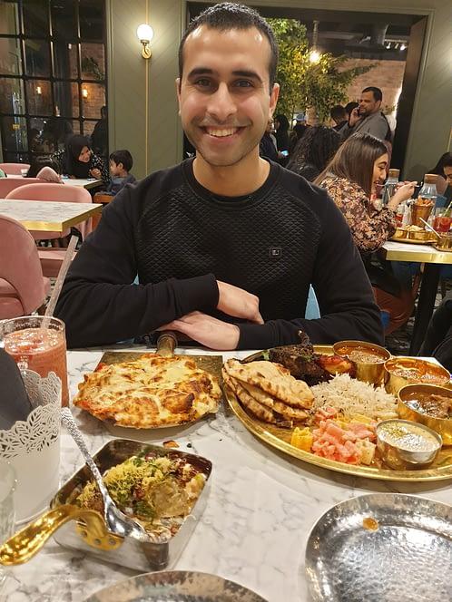 Adil Musa enjoying his meal at Saffron Street