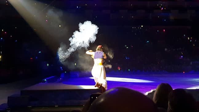 Aladdin summoning his Genie from the lamp